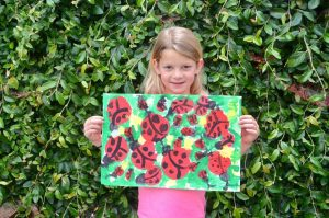 Girl with Lady Bug Painting
